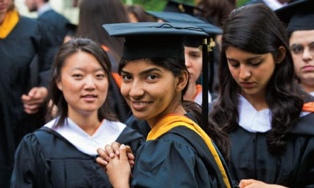 Sharonmoyee Goswami '09, center, and classmates Mary Huang, left, and Sarah Dajani await the start of the Commencement ceremony.