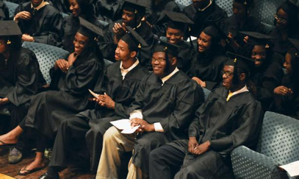 Students listen to Michael Eric Dyson *93's remarks at the Pan-African graduation ceremony.