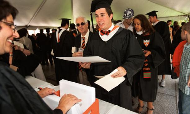 Arthur Ewenczyk '09 picks up his diploma after commencement.