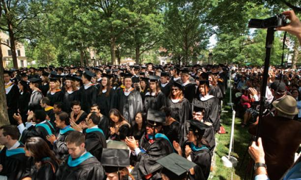 Graduates rise as their departments are called.