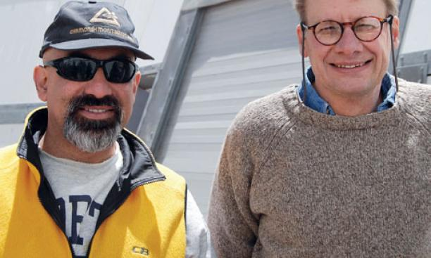 Professors David Spergel '82, left, and Lyman Page at the ACT site.