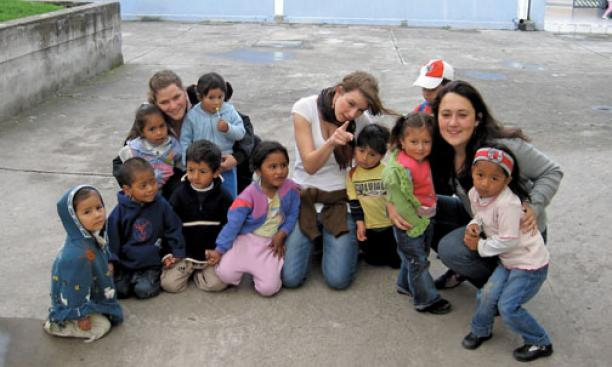 Haley White '12, right, with students she instructs in an open-air market in Ecuador, and other teachers.