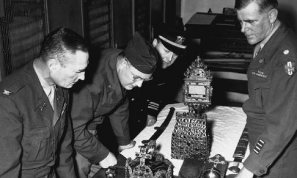 """Monuments Men"" examine relics of the Holy Roman regalia upon their return to Vienna in 1946. Lt. Ernest DeWald *14 *16 is at far right, and Lt. Perry Cott '29 *37 is third from left."