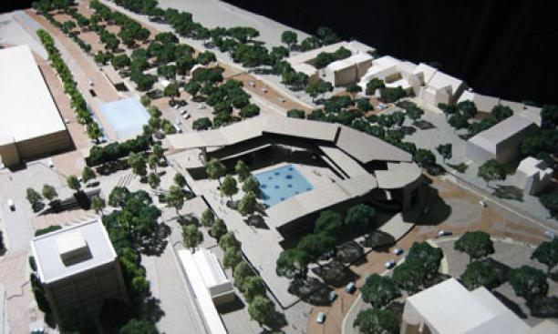 A model of three attached buildings that would provide performance, teaching, and office space for the arts. In the foreground are New South, left, and McCarter Theatre.