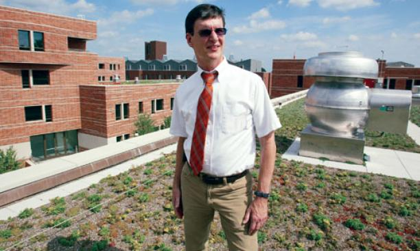 Nick Caputo '73 on a green roof of one of Butler College's new dorms.
