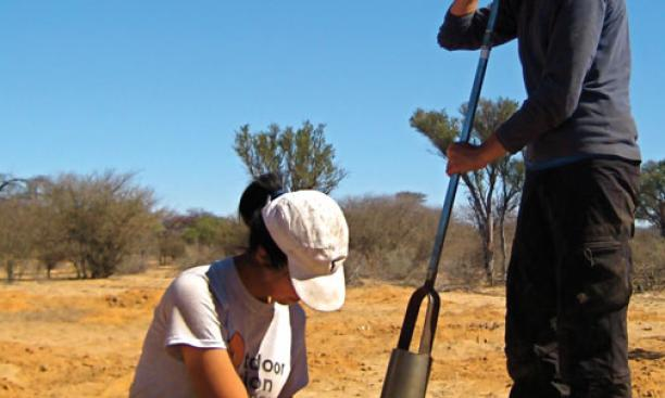 Supported by Grand Challenges funding, Ming Lu '12, left, and Molly O'Connor '11 collect soil samples for laboratory analysis in Botswana.