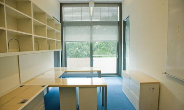 "A senior-faculty office reflects modern styling; sliding-glass doors open onto an exterior ­""balconette."""