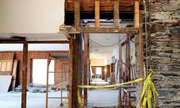 A first floor view of renovations under way at Cannon Dial Elm Club. The stairwell at center is being removed.