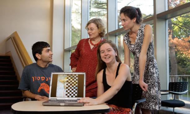From left, graduate student Eugene Brevdo, math professor Ingrid Daubechies, and postdoc Shannon Hughes took part in a contest to identify which of six images of van Gogh paintings was a fake. Charlotte Caspers, far right, created the copy in the artistâ€