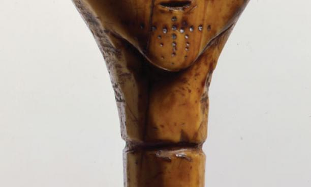 The head of a mechanical doll made of ivory that was excavated by a subsistence digger in the village of Savoonga on St. Lawrence Island and removed from the island in 1974–75.