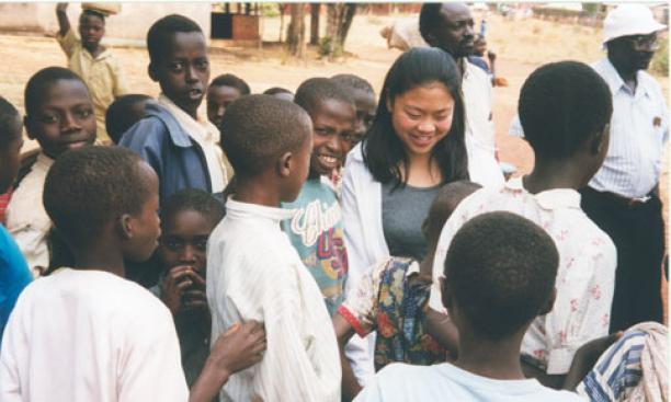 Above, Renee Hsia '99 in Rwanda in 1999. Below: Hsia recently working at a clinic in Sanafe, Eritrea.