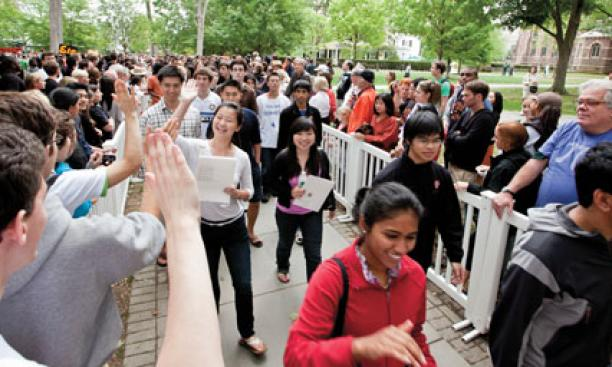 Freshmen receive high-fives as they are greeted in the Pre-rade following Opening Exercises.