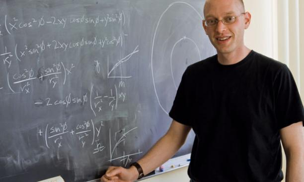 Postdoc researcher Mark Krumholz '98, shown in his office, started Princeton Project Inside.