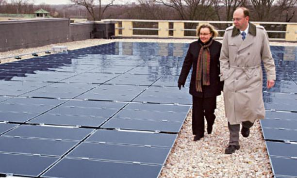 The roof of the Research Collections and Preservation Consortium's storage library on the Forrestal campus houses the University's largest solar-energy installation. Shown are Eileen Henthorne, the consortium's executive director, and Tom Nyquist, P