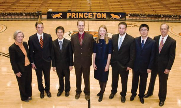 President Tilghman, left, and graduate school dean William Russel, right, with students honored on Alumni Day: From left are Pyne Prize winners Alex Barnard '09 and Andy Chen '09 and Jacobus Fellowship recipients Daniel Bouk, Hannah Crawforth, Peter D