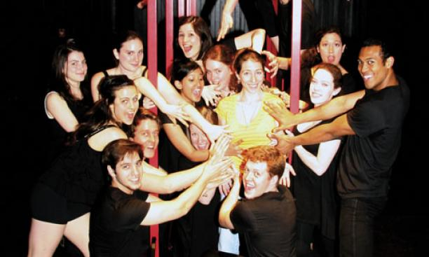 "Pilar Castro Kiltz '10, in yellow, with the cast of ""Liminal."""