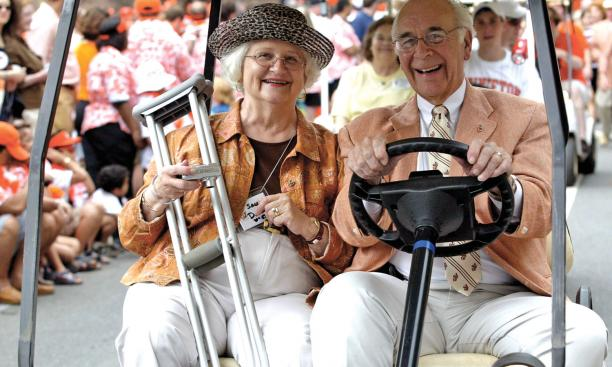James Donnell '53 and his wife, Sally, enjoy the crowd's cheers as they ride in the P-rade.
