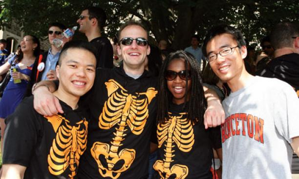 Members of '06, including, from left, Kent Cheng, Robert J. Moore, Stephanie Malone, and Kirk Hou, took their theme from another celebration of orange and black: Halloween.
