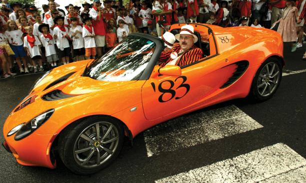 Sev Onyshkevych '83 drives his Princeton-themed orange Lotus in the P-rade.