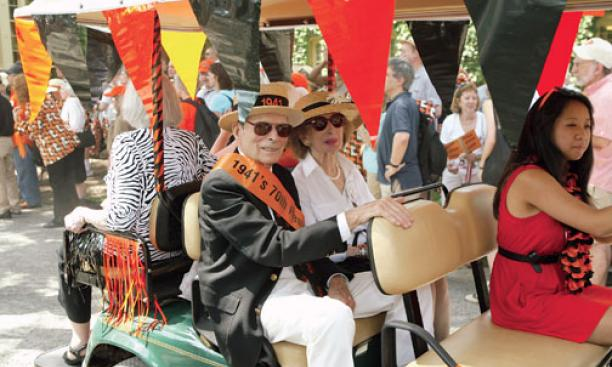 Lou Prince and his wife, Betty, ride along the route at 1941's 70th.