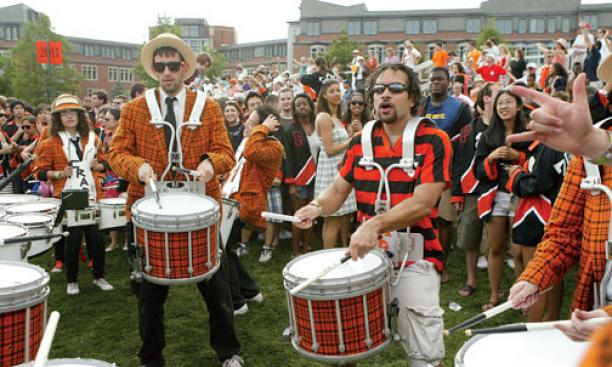 Stan Morton '04 cranks it out with the University Band on Poe-Pardee Field at the end of the P-rade.