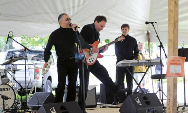 The Funstigators, from left, Ray Gonzalez '84, Kevin Hensley '84, and Charles Sullivan '84, (Steve Buratowski '84, Chuck Steidel '84, and Mark Crimmins '84 are not in photo), perform in the Battle of the Alumni Bands