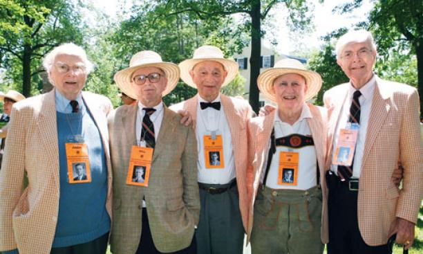 1944's theme, honoring classmates who served in World War II, struck a chord with spectators. Here, classmates Andy McIntosh, Bill Zinsser, Burnham Carter, Lew Doom, and Sandy McDonnell wear dog tags with their Freshman Herald photos.