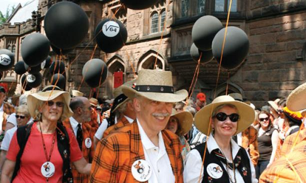 "Jim Williamson '64 and wife Judy celebrate ""1964 evermore"" with eight-ball balloons."