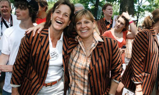 Hilary Bedford Parkhurst '84, left, and Ginny Russell Merrifield '84 enjoy their new jackets — and each other.