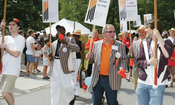 "With a bluegrass band, graduate alumni march to ""PrinceTunes"" in the P-rade."