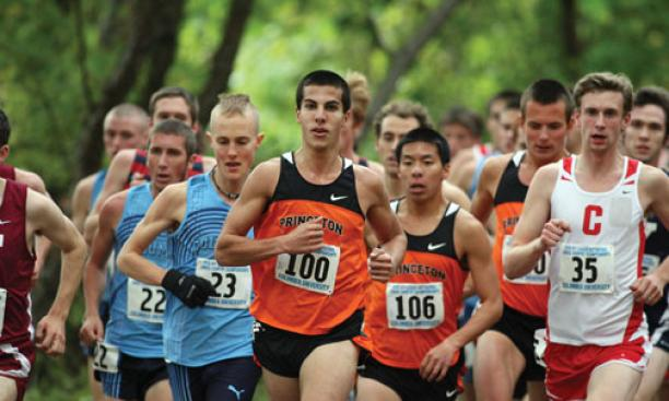 Donn Cabral '12, center, won the men's race with the second-fastest time in Heps history.