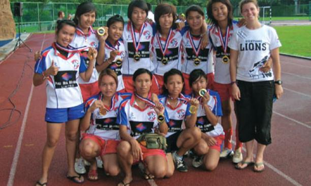 Volunteer coach Elena Olivi '07, right, with the Vientiane Lions.