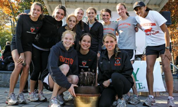The women's cross country team celebrates its 2009 Ivy Championship, the fourth for its seniors, in front row, from left, Reilly Kiernan, Alexa Glencer, and Liz Costello.