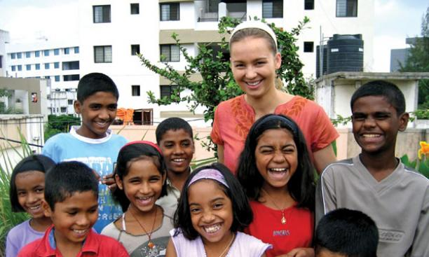 Julia Neubauer '07 with children who live at the home for street children she and other students started in Pune, India.