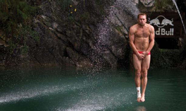 Kent DeMond '07 braces himself before entering the water at the 2010 Red Bull Cliff Diving World Series in Sisikon, Switzerland, in August.