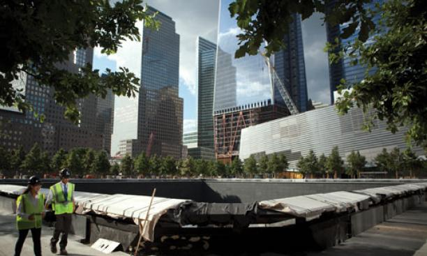 Weisser walks by what will be a reflecting pool inscribed with the names of 9/11 victims.