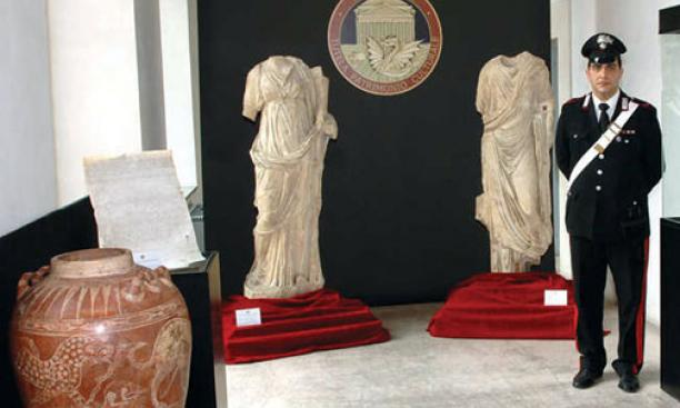 Art objects returned to Italy by American institutions in December were put on display in Rome; the red jar at left appears identical to one given by former antiquities dealer Edoardo Almagià '73 to the Princeton art museum in 1999.
