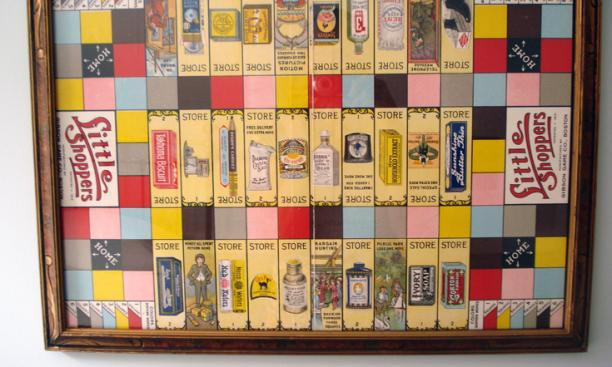 Lefevre put this 1915 Little Shoppers game board in an old frame to hang on the wall.