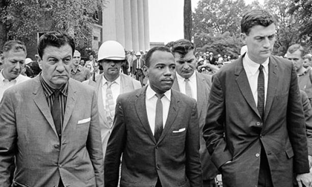 John Doar '44, right, escorts James Meredith at the University of Mississippi in 1962.