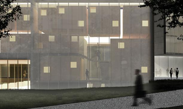 A night view of the music building shows rehearsal rooms visible through a translucent glass wall.