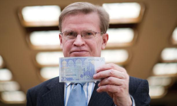 "A new book by ­Professor Harold James, shown holding a 20-euro note, finds ""a crucial flaw"" in the creation of the European Monetary Union."