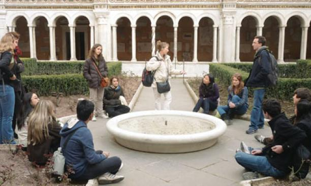 Participants in a 2010 freshman seminar funded by the Class of 1972 visit the cloister of San Paolo fuori le Mura in Rome.