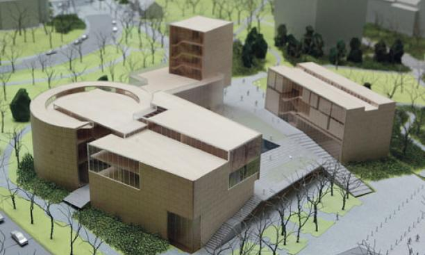An architect's model of the cluster of buildings that will house the Lewis Center for the Arts, including teaching, rehearsal, performance, and administrative spaces. McCarter Theatre is at upper left, and New South at top right.