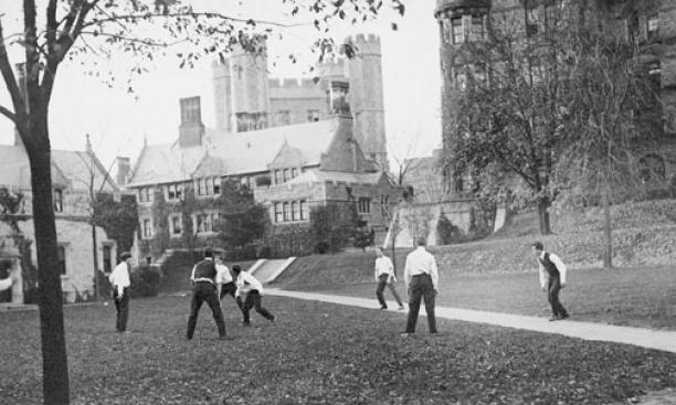 Students play a game of ball behind Witherspoon Hall, circa 1930–50