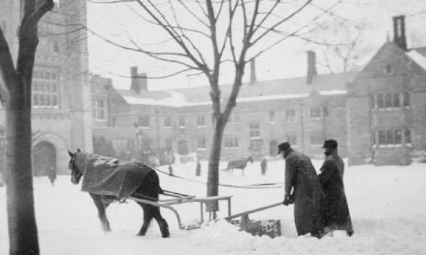 A snowstorm circa 1890 keeps horse-drawn snowplows working in front of Blair Arch