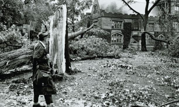 An onlooker assesses damage outside East Pyne after a storm in the 1950s