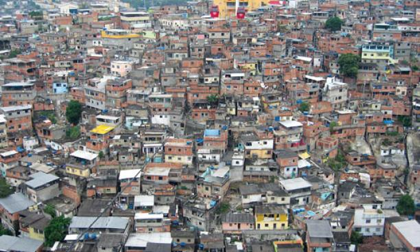 A view of Complexo do Alemão, a shanty town in northern Rio de Janeiro, from a tram used by residents and tourists. Hank Song '11, left, visited some of Brazil's poorest ­neighborhoods as a Princeton in Latin America fellow last year.