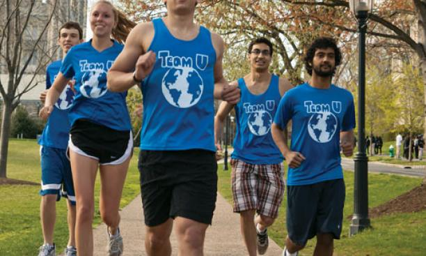 Joe Benun '15, center, trains with members of Team U before a half-marathon April 22 to benefit Shoe4Africa.