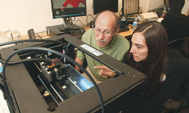 Professor Michael Littman and Cara de Freitas Bart '15 review the results of a 3-D printing test.