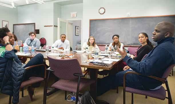 Paul Riley Jr. '15, far right, discusses his thesis with professors and students at a meeting of the African American studies senior colloquium last spring.